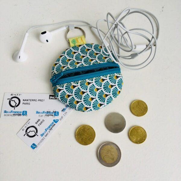 Range écouteurs téléphone turquoise